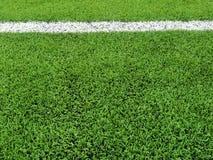Sztuczny trawy pole z białej linii tłem Obraz Stock