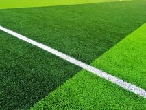 Sztuczny trawy pole z białej linii tłem Zdjęcia Stock