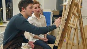 Sztuka nauczyciel i jej aplikant pracuje na akwarela obrazku zbiory