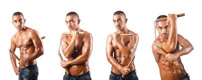 Sztuka samoobrony wojownik z nunchucks na bielu Fotografia Royalty Free