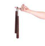 Sztuki samoobrony nunchaku broń w ręce Fotografia Stock