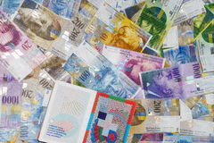 Szwajcarski paszport i pieniądze Obraz Royalty Free