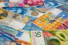 Szwajcarskiego franka monety jako tło i banknoty Obraz Stock