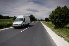 Szybki poruszający samochód dostawczy Obrazy Stock