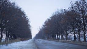 Szybkie unosi się chmury zimy drogi Zdjęcie Royalty Free