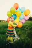 szybko się zwiększać małej kolorowej dziewczyny fotografia royalty free