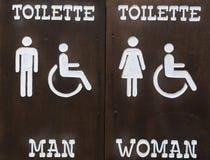 Szyldowe toilette mężczyzna kobiety i obezwładniający Fotografia Stock