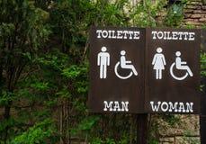 Szyldowe toilette mężczyzna kobiety i obezwładniający Obraz Royalty Free