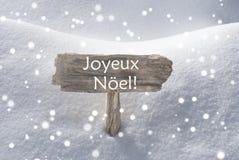 Szyldowi płatka śniegu Joyeux Noel Podli Wesoło boże narodzenia Fotografia Stock