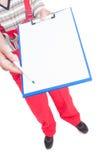 Szyldowi puści papiery na schowku wręcza mechanikiem Fotografia Stock
