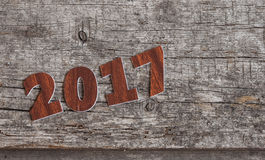 Szyldowy symbol od liczby 2017 na starego retro rocznika stylu drewnianym b Obraz Royalty Free