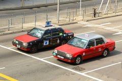 Táxi do vermelho de Hong Kong Urban Imagem de Stock Royalty Free