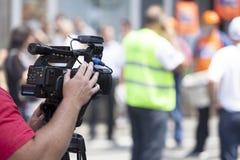 Täcka en händelse med en videokamera Fotografering för Bildbyråer