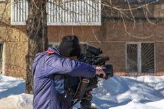 Täcka en händelse på etapp med en videokamera arkivbilder