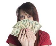 Täckande halv framsida för kvinna med 20 US dollarräkningar Royaltyfri Foto
