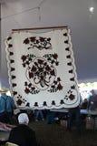 Täcke för Amish blommabukett på auktion Royaltyfria Foton