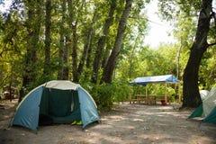 Tältläger som campar Arkivbild