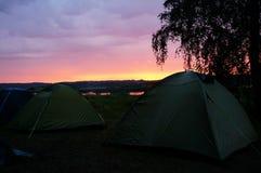 Tältmästare och solnedgång Royaltyfria Bilder