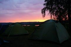 Tältmästare och solnedgång Arkivbild