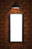 Tänd bildram på en vägg för röd tegelsten Royaltyfri Fotografi