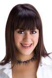 tänder för 1 unga härliga konsolbrunett arkivbild