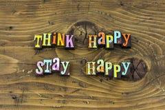 Tänk för glädjemeningen för det positiva staget lycklig boktryck royaltyfria bilder