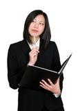 tänkande kvinna för asiatisk affär Arkivfoton
