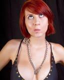 tänkande kvinnabarn för härlig redhead arkivfoton