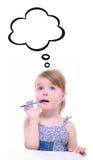 Tänkande liten flicka Arkivfoto