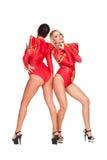 Tänzer in den roten Kostümen Stockbild