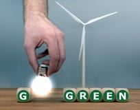 Tärningen och en form för ljus kula uttryckt 'går gröna ', royaltyfri foto