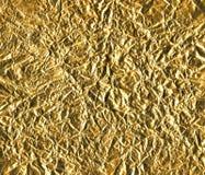 tät guldpapperstextur upp omslagspapperet Royaltyfri Bild
