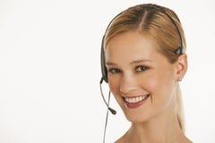 tät hörlurar med mikrofon för affärskvinna upp Royaltyfri Foto