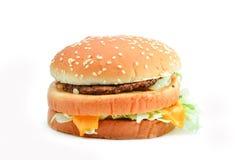 tät hamburgare för bakgrund som skjutas upp white Royaltyfri Bild