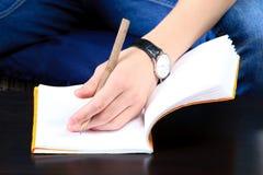 tät handanteckningsbok upp Royaltyfri Foto