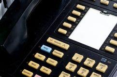 tät kontorstelefon för blue som skjutas som tonas upp Arkivfoto