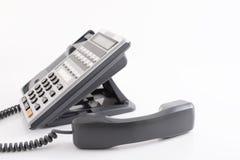 tät kontorstelefon för blue som skjutas som tonas upp Arkivbild