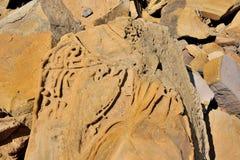 tät sandsandstentextur ukraine upp väggen Arkivfoto