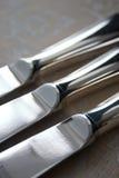 täta knivar silver upp tre Arkivbilder