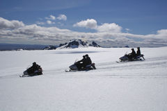 tätare glaciärsnowmobile arkivfoton