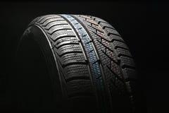 tätt nytt gummihjul för bil upp Arkivbild