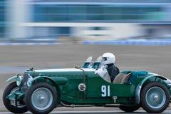 Tävlings- chaufför - tappningsportbil Arkivbild