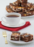 Tè con il dolce di cioccolato Fotografia Stock