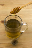Tè con miele Immagine Stock