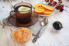 Tè con un limone Fotografie Stock