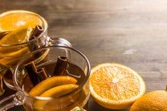 Tè condito con l'arancia e la cannella, arance Fotografie Stock