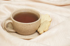Tè e biscotti fotografia stock