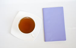 Tè e taccuino Fotografia Stock Libera da Diritti