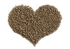 Tè nero granulato - forma del cuore Fotografia Stock Libera da Diritti