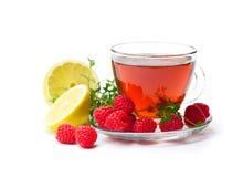 Tè rosso della frutta con il limone ed il lampone isolati su backgr bianco Immagine Stock Libera da Diritti